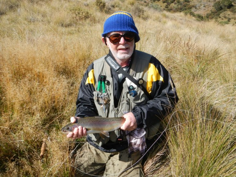 Robin with his nice Rainbow Trout caught and released near Four Mile Hill Fire Trail, Adaminaby