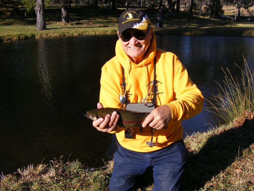 The one that didn't get away - President Iain with his trout caught during the trout fry release