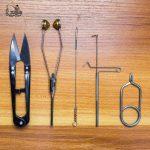Scissors, bobbins, bobbin threader, whip finisher, hackle pliers