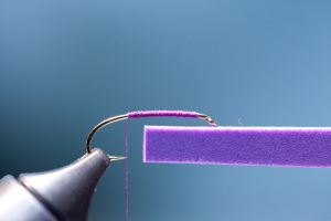Cut a strip of 2mm craft foam. Strip of foam should be width of gap of hook and 2″ long.