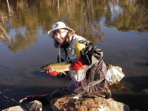 Dawn with her 1.61kg Rainbow caught on a Christmas Beetle fly early Wednesday morning