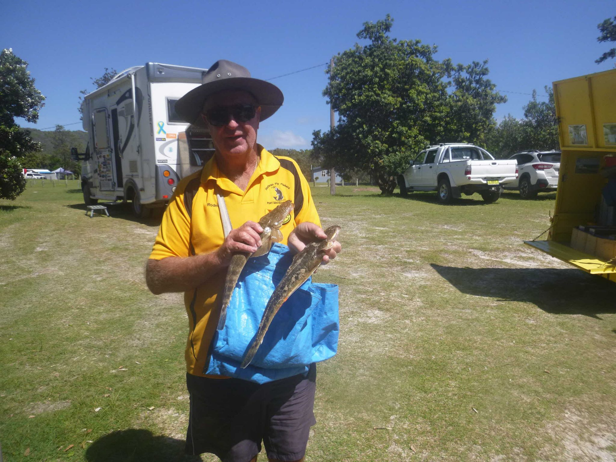 A tail of two fish - Rodney comparing his fish with Ken Dykes'. Hat Head Reserve.